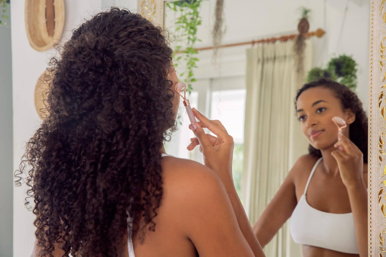 black girl with facial roller